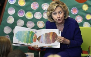 Former Secretary of State Hillary Rodham Clinton reads to children at a children's library and learning center in Little Rock, Ark., Monday, July 8, 2013. The center is being named for the former first lady and secretary of state. (AP Photo/Danny Johnston)